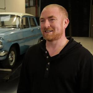 Declan McKearney, with the restored EJ Holden in the background