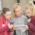Eilis Harlin (left), Dara Conway and Michelle Halpenny checking over their Leaving Certificate Results at St. Vincent's Secondary School