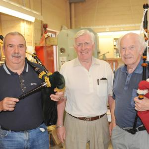 Brian Byrne, with Sean Brown and Owen Hanratty, who played the Bagpipes during the 5th year celebration barbecue at Dundalk Men's Shed, Seatown