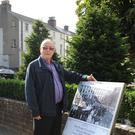 Willie Duffy from Dundalk Tidy Towns committee unveils one of the information boards which are part of the Victorian Dundalk walking tour