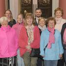 Argus reporter, Margaret Roddy (fourth right), with members of the Cara Cancer Support Group at the 'Light up for breast cancer' event at the Town Hall