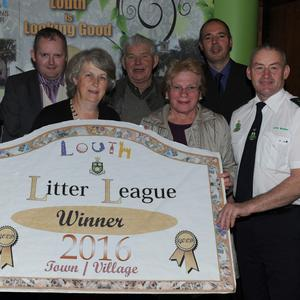 Kilcurry representatives Maura and Jackie Callan, Noel McKay and Aileen McBride receive their Litter League winners award from Cllr. Conor Keelan and Litter Wardens Eugene Birch and Martin Reilly at the Louth Looking Good Awards held in the Crowne Plaza. Photo: Ken Finegan