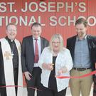 Sr. Joan Watters, Brendan Henry, Kilcawley Construction, Archbishop Eamon Martin, Children's author Marita Conlon-McKenna, Stephan Carter, Coady's Architects and Principal, Marcella Ó Conluain at the official opening of the new extension at St. Joseph's National School