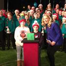 Aimee and Aaron Collins with News2Day presenter Gill Stedman turn on the Christmas lights at RTÉ