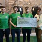 The Fighting Fit team presenting a cheque to Yvonne from Dundalk Simon Community after the Hell and Back Night fundraiser