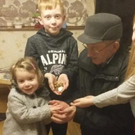 Max, Mia and Ali hand over their 'fistful of money' to their grandfather Tom Byrne, a volunteer in the Soup Kitchen