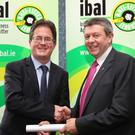 Paddy Donnelly, Director of Service, Louth County Council, accepts the scroll from Conor Horgan, Irish Business Against Litter (IBAL)