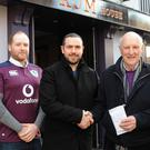 James Robinson and Gerry Morgan, The Rum House/Ridleys nightclub make a donation to Kevin Mulligan, President, Dundalk Area St. Vincent de Paul
