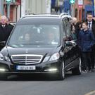 The remains of the late Brendan McGahon with a guard of honour by members of Fine Gael arrive at St. Patrick's Cathedral. Picture: Ken Finegan
