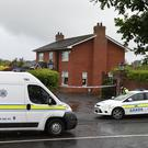 Gardai attend the scene of the Quigley murder in Kilkerley