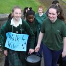 Dun Lughaidh students Natasha Kearney and Laura Maguire take part in the 'Walk for Water' initiative