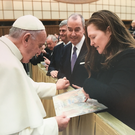Dundalk artist Michelle Rogers presents one of her paintings to Pope Francis