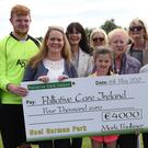 Palliative Care nurses Joanne McElduff and Angela Watters with family of the late Mark Faulkner at the presentation of a cheque for €4,000 to Palliative Care Ireland at the charity match held in Gorman Park. Picture: Ken Finegan