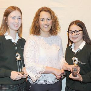 Elaine Byrne with (l-r), Kayla Byrne, Amy Lawlor and Róisín Curley, winners of the U14, U16 and U19 Gaelic awards at the St. Louis Secondary School awards night.