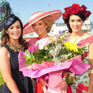 Donna Mackin (centre), winner of the Best Dressed Lady Competition at Dundalk Stadium, with sisters, Adele Digney and Kelly O'Hare
