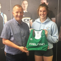 St Gerard's AC's Kate O'Connor, who will represent Ireland, receives her new kit from David Minto
