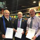 Declan Breathnach TD with Benny Gilsenan from Benny's Shop North Circular Road on the left and Brian O'Carroll owner Spar Shop Lower Liffey Street, right