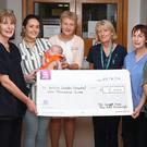 Edel Kavanagh and her son Patrick called in to see the team at the Neo Natal ICU at Our Lady of Lourdes Hospital and brought along a cheque for €1000. Patrick spent 8 weeks in the unit having been born at 28 weeks.