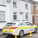 A Garda patrol car parked outside the house at Mary Street North where a workman found 'historical skeletal remains'