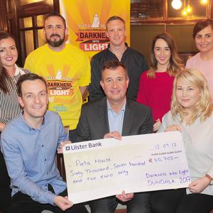 The Darkness into Light Committee in Dundalk present a cheque to Tom McEvoy of Pieta House. Included are, Sean Kelly, Orla Sheridan, Helena Mullen, Johann Crawford, Pairic Browne, Sarah MacClancy and Chloe Enright