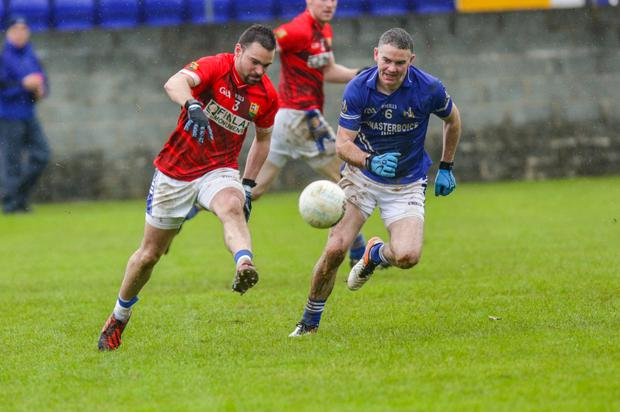 Brendan (right) in action for the Mairtin's against St Mary's last Saturday