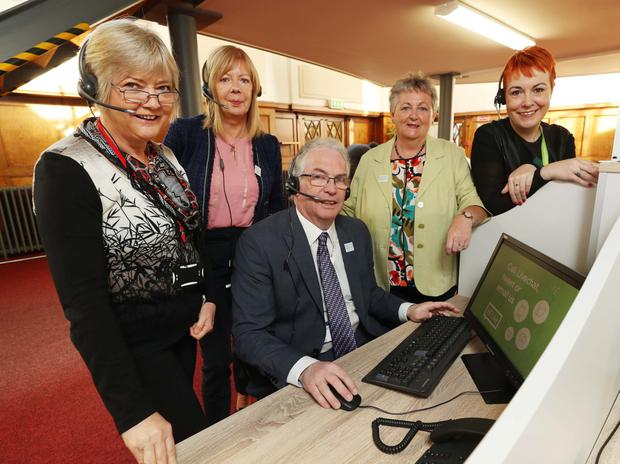 Tony O'Brien, Director General, HSE, pictured in St Brigid's Complex with Multi Channel Information Officers (left to right): Geraldine McCarville, Shirley Magennis, Geraldine Charman, Team Leader and Lorraine Reaburn