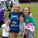 Janet Moroney pictured with her children following a run