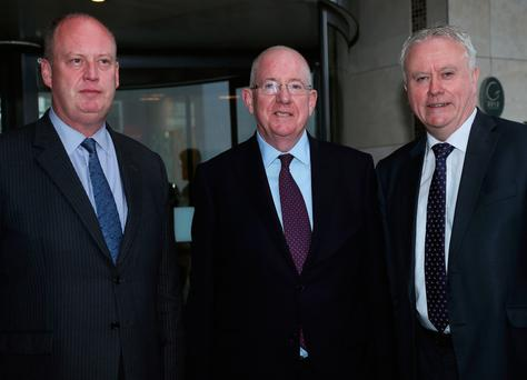 Justice Minister Charlie Flanagan (centre), Acting Garda Commissioner Donal O Culain (right), and Chief Constable George Hamilton attend the Cross-border conference on organised crime at the Crowne Plaza Hotel, Dundalk. Photo: Brian Lawless/PA Wire