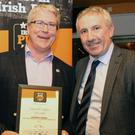 Greg Gormley (centre), Russell's, Park Street being presented with one of the awards