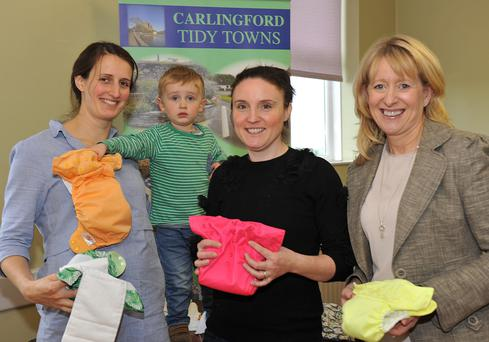 Gill and James Toal with Joanne Redpath, Carlingford Tidy Towns and Aisling Sheridan, Louth County Council at the launch of the 'Not all Nappies are Rubbish' campaign during the 'Cooley Parent and Toddler Group' Hallowe'en meeting.