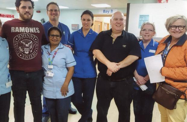 Daniel Browne with his medical team in Leicester.