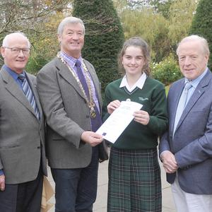 Seamus McDermott, President, Dundalk Rotary Club, with Caoimhe Matthews, St. Louis Secondary School, Winner of the Club Final Stage of the Youth Leadership Development Competition, with Sean O'Hanrahan and Paddy Williams, Dundalk Rotary Club, along with Tom D'Arcy and Majella Downey