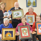 Kay O'Keeffe, Director of Nursing at St. Oliver Plunkett Community Unit, with Artist, Carol Wallace, with a range of Christmas cards, made from paintings by the 24 members of the St. Oliver's Art Group which will be for sale in local shops from 20th November. The cards are also for sale at St. Oliver Plunkett Community Unit. Some of the members included in the photo are, Gerry Scorr, Briege Treanor, Vincent McEvoy, Joan Reilly, Sheila Hanill, Brigid Connolly and Barney Sharkey
