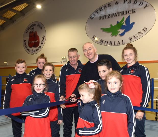 John Fitzpatrick and Paul Taaffe, founding member of the O'Hanlon Park Boxing Club pictured celebrating the official opening of the new club with some of the younger members. Picture: Ken Finegan