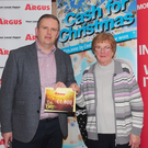 Argus Editor, John Mulligan, presents the top prize of €4,000 to Margaret Carroll in The Argus 'Cash for Christmas' Competition final in The Ballymascanlon House Hotel