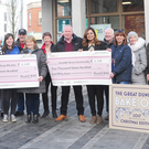 Rose Bailey, St. Patrick's Soup Kitchen and Yvonne Carr, Dundalk Simon Community each receive a €2,750 cheque from members of The Great Dundalk Bake Off teams from Conlon's Food Hall and Eskays Bistro and other participants at the Dundalk BIDS Centre, Market Square