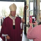 Archbishop Eamon Martin poses for his portrait at the 25th Anniversary of the Holy Family Church