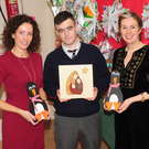 Eimear Marron, WALK PEER Programme, with Philip McArdle and Teacher, Elaine Kelly at the 'Wooden Christmas Craft Creations' pop up sales stand in St. Brigid's National School