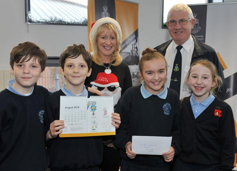 Darragh Burke, Amy McEvoy, Matthew Burke and Darcy Maguire, St. Oliver Plunkett's NS, Blackrock, 'August' winner in the 'Design a Mascot' competition pictured receiving their awards from Aisling Sheridan, LCC and Litter Warden Eugene Birch at the launch of the Louth County Council Environmental Awareness Calendar for 2018 held in County Hall