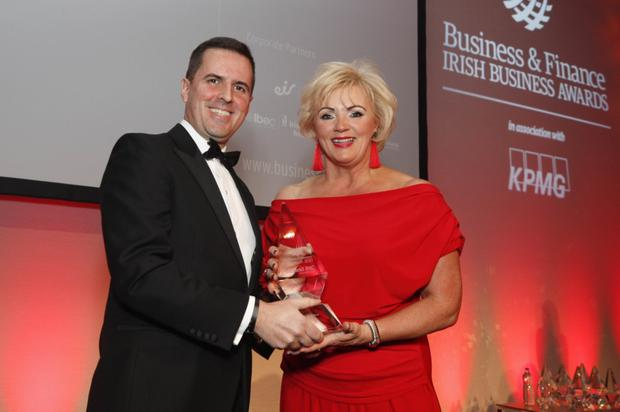Martin Shanahan, CEO, IDA Ireland, presenting the award to Louise Phelan, Vice President, Continental Europe, Middle East and Africa, PayPal