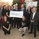 The committee and supporters of the Laugh Out Louth festival with the cheque which was presented to the Samaritans.