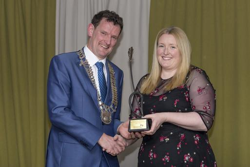 Presentation of trophy for the Best Established Business by Cllr Colm Markey, Cathaoirleach Louth County Council, to Nikki Reddy of Celtic Adventures.