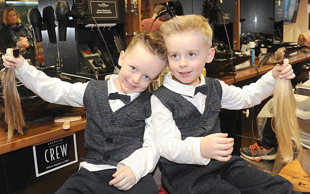 Logan and Lennix Cumiskey displaying their hair they got cut by Pat Rogers in Blade FX Gents Barbers, Clanbrassil Street.