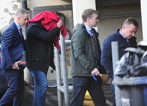 Niall Power (covered by red towel), a 45-year-old married father of four of Gyles Quay, Riverstown, Dundalk pictured being taken from Dundalk District Court last Thursday morning after he was charged with the murder of Irene White.