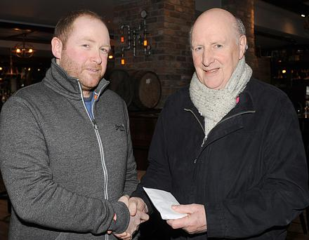 James Robinson, Ridleys Nite Club makes a presentation to Kevin Mulligan, St Vincent de Paul.
