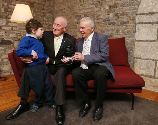Johnny Giles presents the Specsavers Grandparent of the Year Award to Packie McGuinness, pictured with his grandson James.