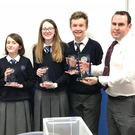 Dundalk Grammar School students Vishva Nagappan, Síofra O'Reilly,Kate O'Brien and Ryan Carroll receiving their awards from Joe McEneaney, Chairman of the Irish Applied Maths Teachers Association