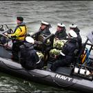 Members of the Naval Service transfer wreaths to the LE Niamh from the shore in a RIB. They were then transported to Blackrock lighthouse completing the ceremony following the Memorial service of the crew of Rescue 116 at Blacksod lighthouse