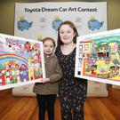 Pictured were sisters Alice Evelyn (age 6) and Katie Mia O'Shaughnessy-Larkin (age 11) from Louth both receiving overall winners in their categories at the Toyota Dream Car Art Contest Ceremony at Haughton House, Dublin Zoo