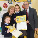 Alice O'Shaughnessy-Larkin, Scoil Mhuire na nGael, Overall Junior Category Winner of ESB Networks 'Stay Safe, Stay Clear' poster competition and Sanese Lamberga, Scoil Mhuire na nGael, Senior Leinster Winner pictured with Arthur Byrne, Public Safety Manager, ESB Networks and Principal, Martina Rafferty at the presentation of their prizes